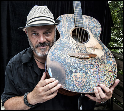 Nicholas Barron with his handpainted guitar